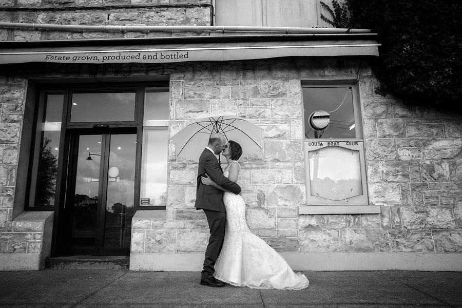 beach box photography - wedding couples - a kiss in the rain